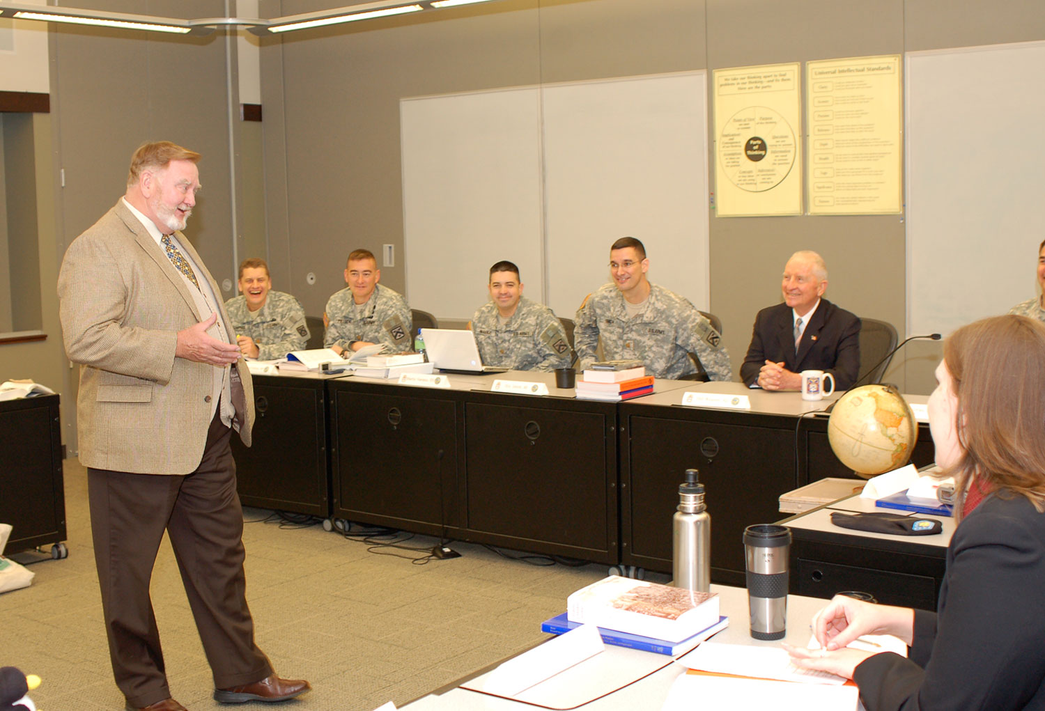 Ross Perot, seated right, participates in class discussion with CGSC Professor Bud Meador and students, during his visit to the College, Oct. 20, 2009.