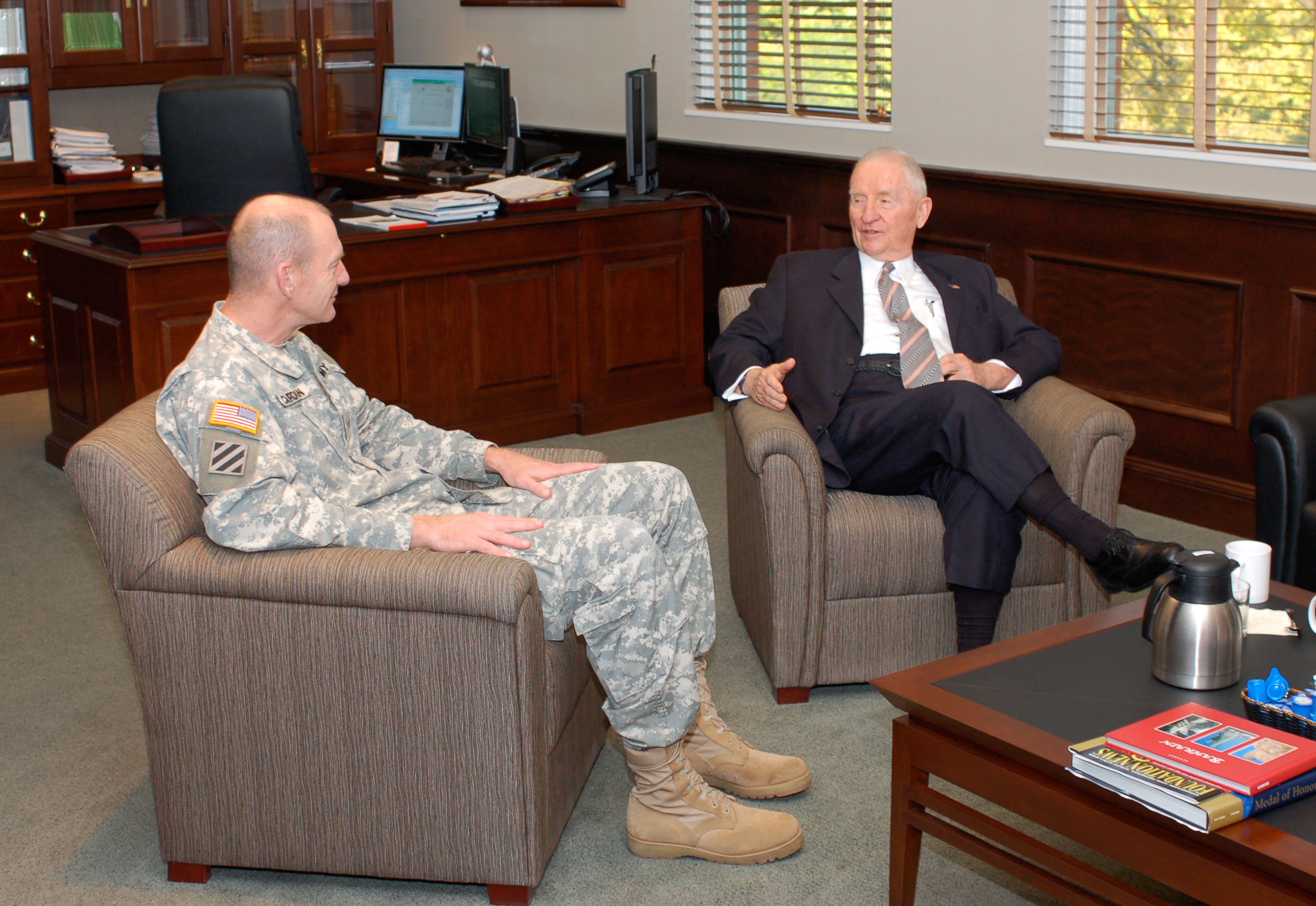 Ross Perot, right, converses with Brig. Gen. Edward Cardon, deputy commandant of the U.S. Army Command and General Staff College, during a visit to the college, Oct. 20. The CGSC Foundation sponsored the visit after which Perot elected to contribute $6.1 million to two new programs the foundation is establishing in support of CGSC.