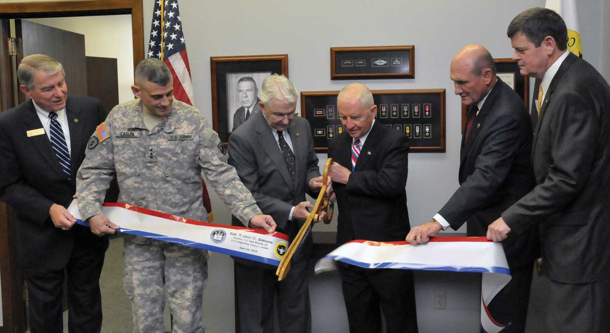 From left, Foundation CEO Bob Ulin, Fort Leavenworth Commander/CGSC Commandant Lt. Gen. Robert L. Caslen, Jr., Foundation Chairman Lt. Gen. (Ret.) Robert Arter, Ross Perot, Foundation President Hyrum Smith, and the Chief Operating Officer of the Simons Center, Maj. Gen. (Ret.) Ray Barrett, cut the ribbon for the opening of the Col. Arthur D. Simons Center for the Study of Interagency Cooperation, April 21, 2010. (photo by Don Middleton, Fort Leavenworth VISE)