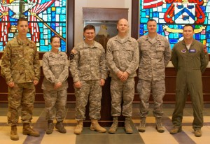 """The complete 2016 Bell Yearbook staff, left to right in the photo above: Maj. Mike Centola, content creator; Major Carla Gleason, finance officer;  Maj. Lance Brender, editor-in-chief; Maj. Don Tinsley, international military student coordinator; Maj. Howard Moore; information technology officer; Major John """"Chappy"""" Chapman, portrait officer. Not pictured: Maj. Jack Irby, content editor; Shae Koonce, photographer; Molly Baker, production liaison."""