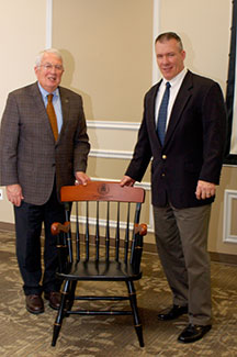Foundation Chairman Lt. Gen. (Ret.) John Miller, left, presents Dr. Daniel M. Bell, Jr., the outgoing General Hugh Shelton Distinguished Visiting Professor of Ethics for CGSC, with a College chair in recognition of his service as the chair. Click the photo to visit the complete photo gallery.