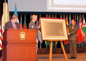 Lt. Col. (GS) Hans-Jakob Reichen, Switzerland and Maj. Muhammad Iftitah Sulaiman, Indonesia, present the international officer class of 2016 gift to the College during the International Officer Badge Ceremony June 9. – Click the photo to view the gallery of all photos of the ceremony.