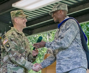 Maj. Whitmore receives his MMAS from Col. Douglas Cardinale, Director of the Command and General Staff School, during the CGSOC Class of 2016 graduation on June 10.