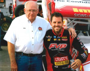 During his tenure as president/CEO of Casey's General Stores, Bob Myers spends time at the track with Brian Brown, the top Sprint car driver that Casey's sponsors.