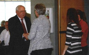 Bob Myers greets guests at his retirement ceremony April 30, in Ankeny, Iowa.