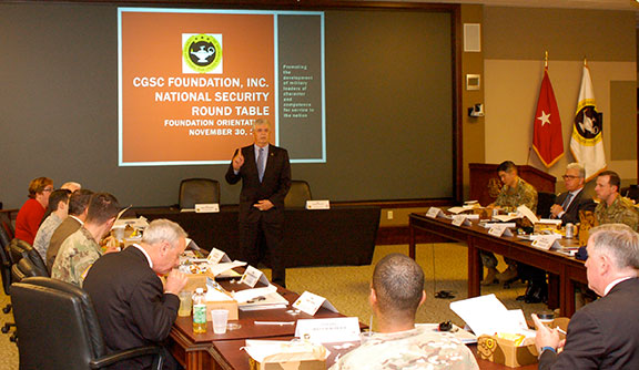Foundation CEO Doug Tystad provides an orientation briefing about the Foundation and its operations to the attendees of the National Security Roundtable on Nov. 30.