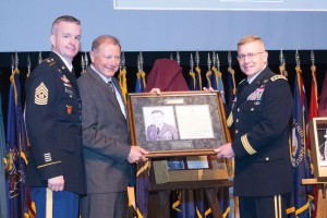 From left, Command Sergeant Major David O. Turnbull, Command Sergeant Major, U.S. Army Combined Arms Center (CAC)/Fort Leavenworth; Brig. Gen. (Ret.) Huba Wass de Czege; and Lt. Gen. Michael D. Lundy, Commanding General, CAC/Fort Leavenworth and Commandant, U.S. Army Command and General Staff College, unveil de Czege's Fort Leavenworth Hall of Fame shadow box during the IHOF induction ceremony May 11.