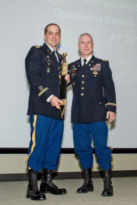 Maj. Scott Harr receives the Roman Gladius sword, signifying his selection as the LTC Ronald C. Ward Distinguished Special Operations Forces Student Award for the Command and General Staff Officer Course Class of 2017. Presenting is Col. Paul Schmidt, director of the Combined Arms Center Special Operations Forces Directorate.