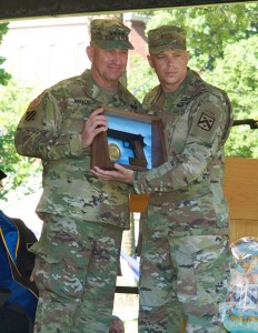 "Major Trevor M. Jones, U.S. Army, receives the General George C. Marshall Award for the top U.S. graduate from Gen. Robert B. ""Abe"" Abrams during the CGSOC graduation ceremony June 9."