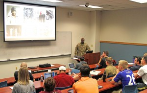 Col. Oscar Doward, Jr., commander, 2503rd Digital Liaison Detachment, U.S. Army Central, gives a lesson to students on African-American Soldiers and their participation in World War I at the University of South Carolina, Columbia. (U.S. Army Photo by Staff Sgt. Jared Crain)