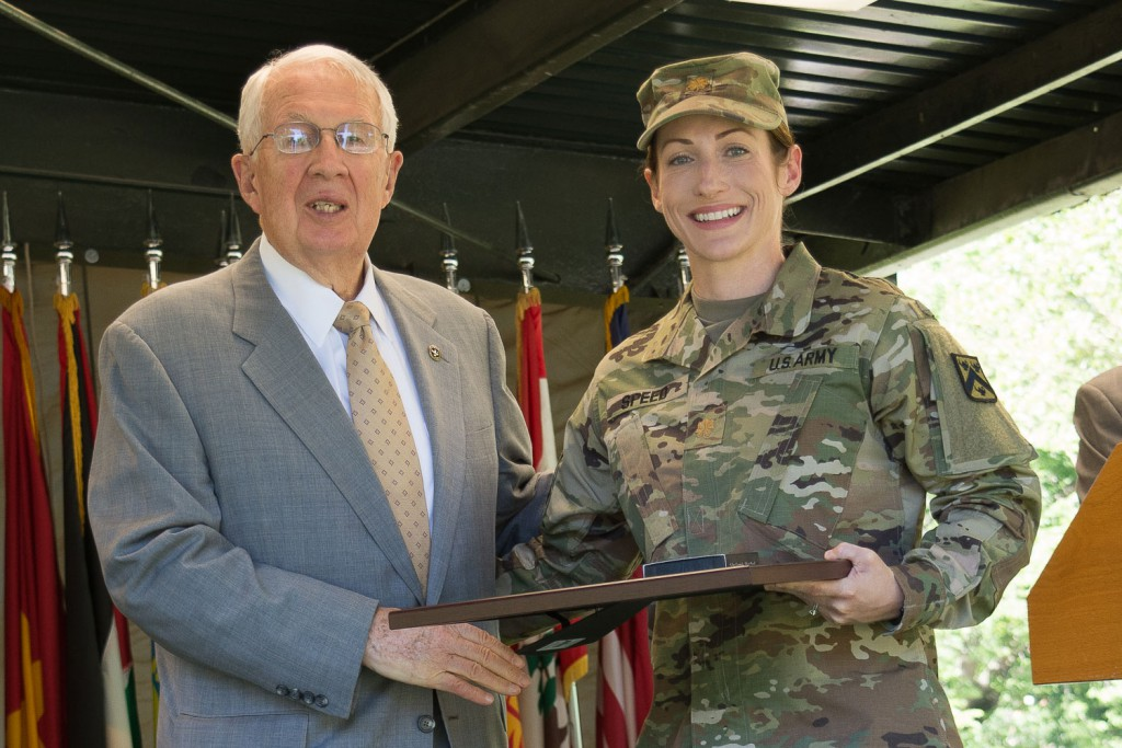 CGSC Foundation Chairman Lt. Gen. (Ret.) John Miller presents Maj. Genna Speed with her award during the graduation ceremony June 9.