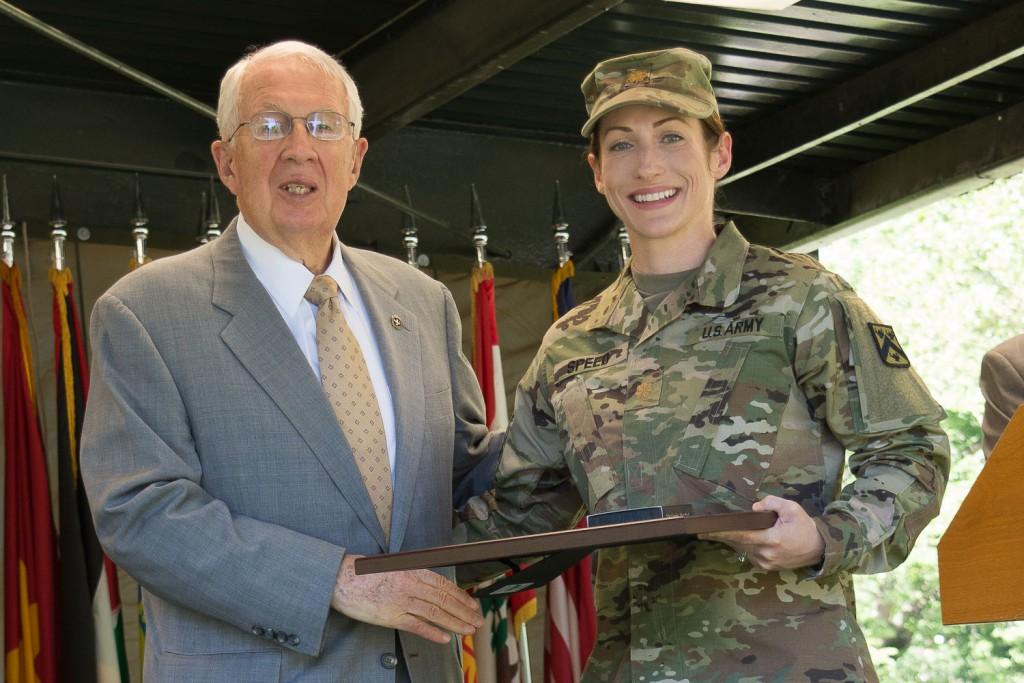 CGSC Foundation Chairman Lt. Gen. (Ret.) John Miller presents Maj. Genna Speed with her award during the graduation ceremony June 9.