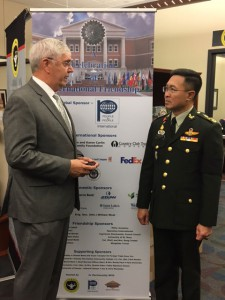Foundation CEO Doug Tystad presents Gen. Surapong with a Foundation coin.