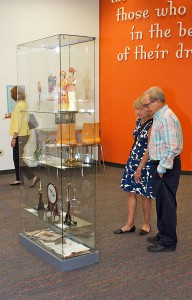 """A couple views the art objects on display during opening night of the Art of War: Gifts of Peace exhibit entitle """"Truth and War."""""""