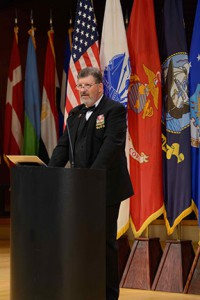 Jim Fain, director of the International Military Student Division of CGSC, introduces the international officers by country as part of the program.