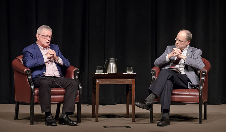 "UN Assistant Secretary-General Kevin M. Kennedy, left, and Dr. Jack Kem, CGSC associate dean, conduct a professional development ""fire-side chat"" Oct. 19 in the Eisenhower Auditorium of the Lewis and Clark Center.(Photo by Dan Neal/ArmyU Public Affairs)"