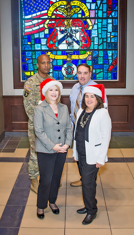 Clockwise from back left: Capt. Rafael Dominguez, Operations/Action Officer; Mr. Charles Davis, Deputy/Operations, Mrs. Olga Escobedo, Administrative Assistant; Mrs. Rita Durocher, Chief, Visitor and Ceremonies Office