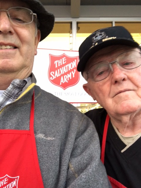 Foundation CEO Doug Tystad, left, and trustee Brig. Gen. (Ret.) Stan Cherrie ring the bell for the Salvation Army.