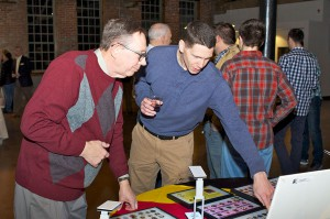 Vietnam militaria collector Joe Grasela, left, discussed some of his unit crest collection with an attendee at the Vietnam lecture Jan. 31.
