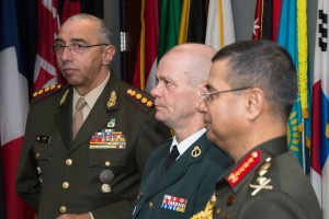 Lt. Gen. Luis Suñer, Argentina, Maj. Gen. Jørgen Høll, Denmark, and Gen. Abu Belal Muhammad Shafiul Huq, Bangladesh Army look on as their photos are added to the U.S. Army Command and General Staff College International Hall of Fame following an induction ceremony in their honor on March 1 at Fort Leavenworth's Lewis and Clark Center. (U.S. Army Photo by Jim Shea)