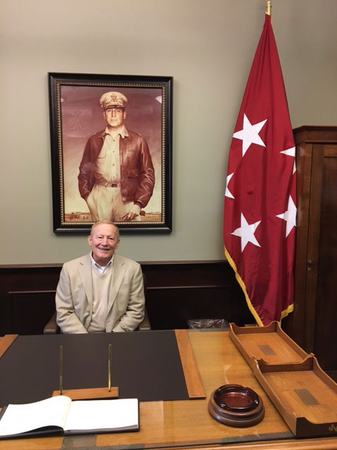 Former Garmin executive Gary Kelley takes a seat at the former desk of Gen. MacArthur in the MacArthur Room of the Lewis and Clark Center during his walk and talk tour of Fort Leavenworth and the Command and General Staff College March 13.