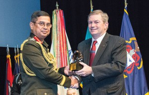 CGSC Foundation Chairman Mike Hockley presents an eagle statuette to Gen. Abu Belal Muhammad Shafiul Huq, Bangladesh Army. Each inductee received a statuette and Life Constituent certificate from the CGSC Foundation.