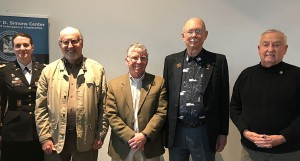 Fort Leavenworth Garrison Commander Col. Marne Sutten, left, presented Vietnam Veteran Lapel pins to (from left) Larry Hamby Mike Delaney, John Reichley, and Bruce Eveland at the beginning of the lecture March 1.