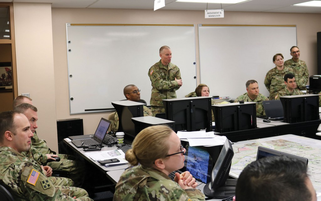 Brig. Gen. Aaron T. Walter, commanding general of the 100th Training Division, visits with TASS students at the Fort Belvoir CGSS Satellite Campus March 10.