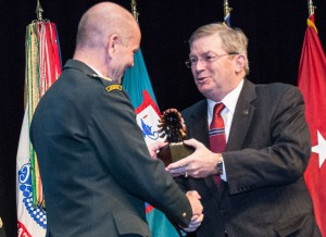 CGSC Foundation Chairman Mike Hockley presents an eagle statuette to Maj. Gen. Jørgen Høll from Denmark during the induction ceremony for the CGSC International Hall of Fame on March 1, 2018. Each inductee of the IHOF receives a statuette and Life Constituent certificate from the CGSC Foundation.