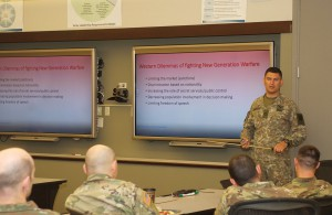 "Maj. Egidijus Cuitas, an international military student in the current CGSOC class, presents his award-winning paper during a breakout session at the 2018 Fort Leavenworth Ethics Symposium. His paper entitled ""Criminal Ethos of Russia – The Great Western Dilemma of Fighting New Generation Warfare"" was one of two selected as the top papers for the symposium."