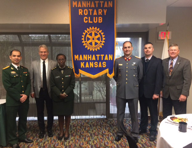 Capt. Hieu Le from Vietnam, DJIMO Professor John Cary, Capt. Lausanne Nsengimana from Rwanda, Lt. Col. Enrique Reboler from Chile, Brian Hamil, interagency student from the Defense Intelligence Agency, and Manhattan Rotary Club President Vern Henricks, at the MRC meeting in March 2018.