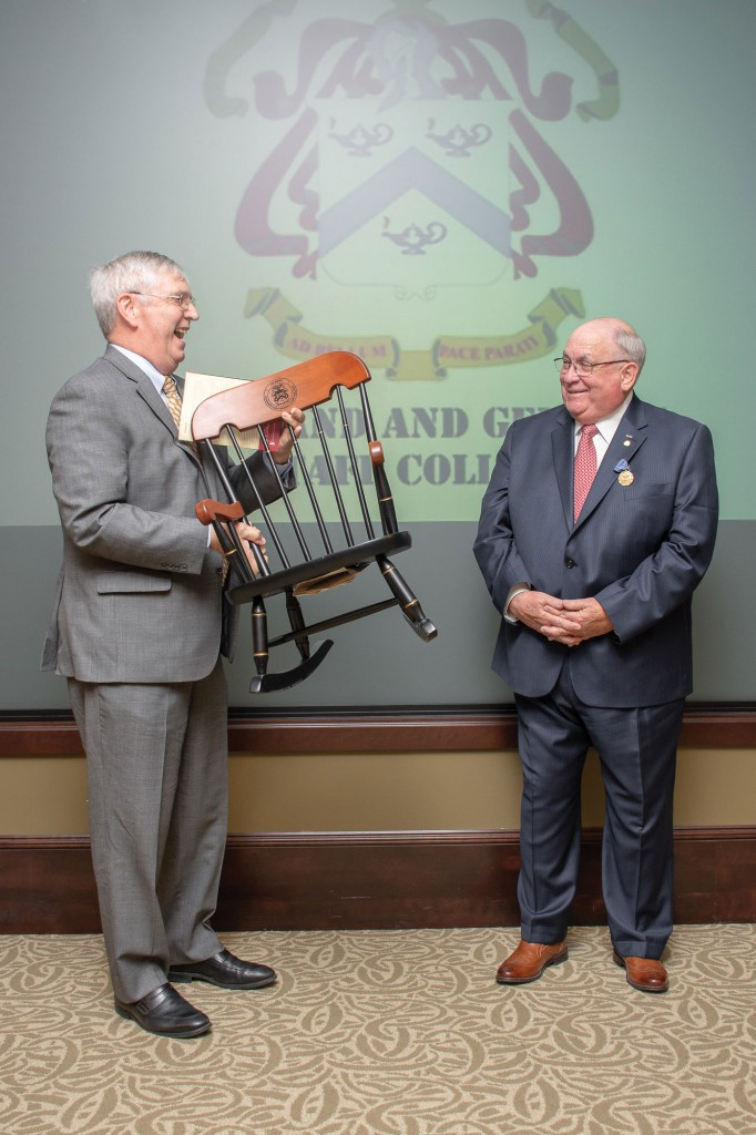 Foundation President/CEO Doug Tystad presents a child-sized College Chair to Dr. Jim Willbanks, drawing laughter from everyone in attendance during Willbanks' retirement ceremony April 24.
