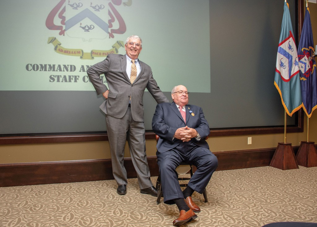 After a few laughs with a child-sized chair, all is right in the world again as Dr. Willbanks lays claim to his actual full-sized chair presented by the CGSC Foundation in recognition of his selection as CGSC Professor Emeritus.