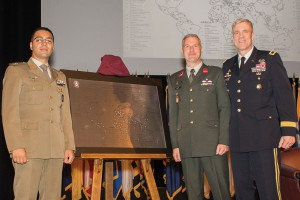 Majors Stefano Catania, Italy (left), and Rene Berendsen, Netherlands, present the International Military Student Class of 2018 gift to Brig. Gen. Scott Efflandt during the International Military Student Badge Ceremony June 14. The gift is a map showing the names and countries of the 119 international students graduating from Command and General Staff Officers Course 2018.