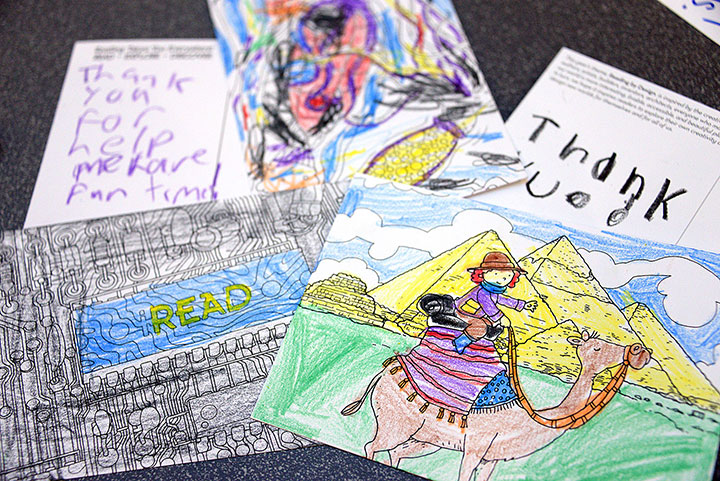 Children and parents colored these postcards to send thank-you messages to the Command and General Staff College Foundation, which helps sponsor the summer reading program, at one of the activity stations at the program kickoff event June 1 at the Combined Arms Research Library.