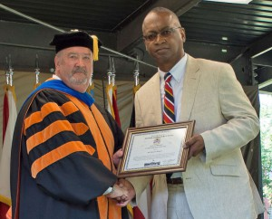 Mr. Dwayne Wagner, right, accepts the award for the 2018 Civilian Educator of the Year from CGSC Dean of Academics Dr. Jim Martin during the CGSOC graduation ceremony on June 15, 2018.