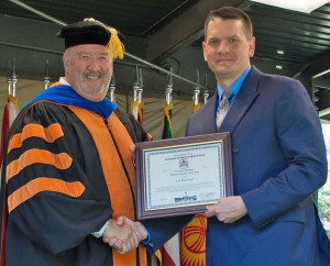 Lt. Col. (R) Brian Steed, right, accepts the award for the 2018 Military Educator of the Year from CGSC Dean of Academics Dr. Jim Martin during the CGSOC graduation ceremony on June 15, 2018.