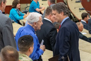 Kansas Governor Jeff Colyer talks with Lt. Gen. (Ret.) Robert Arter, Chairman Emeritus of the CGSC Foundation and Civilian Aide to the Secretary of the Army (Emeritus), before presenting certificates of completion to graduates of the Hiring our Heroes Corporate Fellowship Program at Fort Leavenworth July 26.