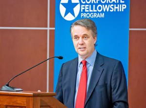 Kansas Governor Jeff Colyer talks with graduates of the Hiring our Heroes Corporate Fellowship Program during the ceremony July 26.