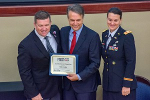 Kansas Governor Jeff Colyer and Col. Marne Sutten, Fort Leavenworth Garrison Commander, present a certificate of completion to Nick Crosby during the Hiring our Heroes Corporate Fellowship Program graduation at Fort Leavenworth July 26. Crosby did a fellowship with Cerner Corporation as part of his transition from military to civilian life. Cerner was one of 19 organizations to host fellowships during the 12-week program that completed July 26. (Photos by Dan Neal/ArmyU Public Affairs)