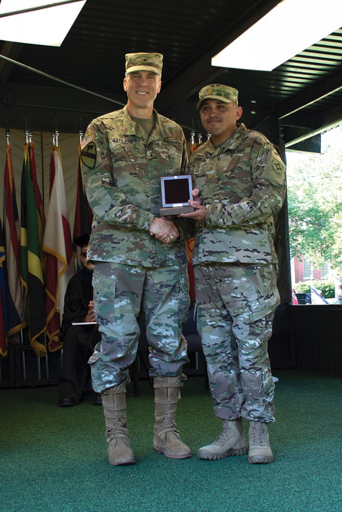 Army University Provost and Deputy Commandant of the Command and General Staff College, Brig. Gen. Scott Efflandt presents the Pershing Award to Maj. Oscar Torres as the outstanding student graduate in the CGSOC's Department of Distance Education.