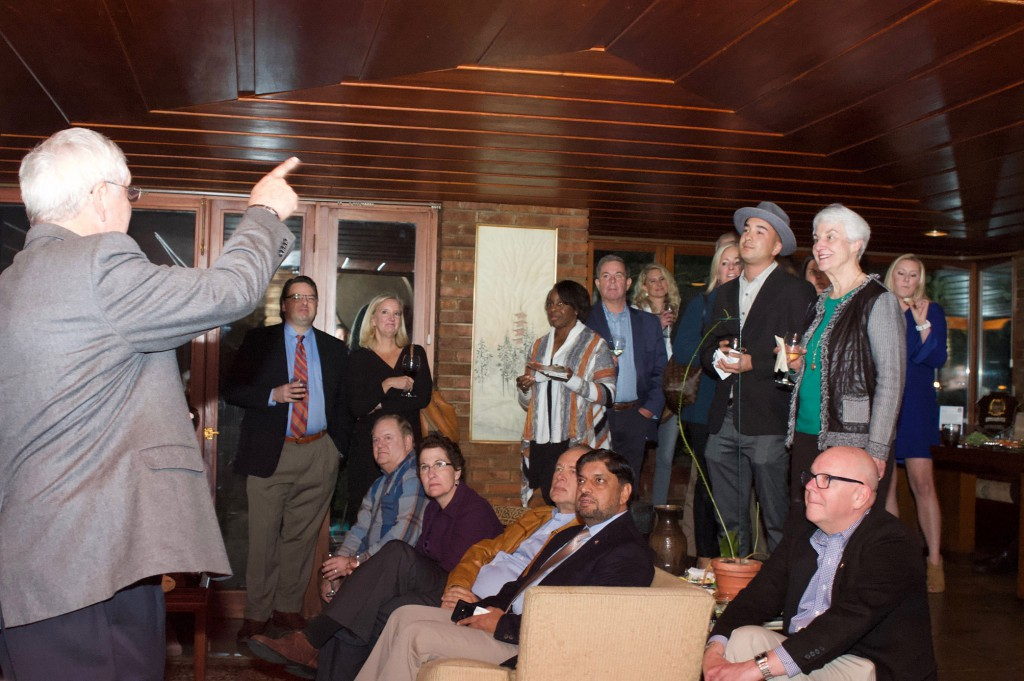Foundation President/CEO Doug Tystad, left, conducts an impromptu history lesson for attendees at the fundraiser conducted Oct. 25 at the Frank Lloyd Wright home of Jim Blair in Kansas City.