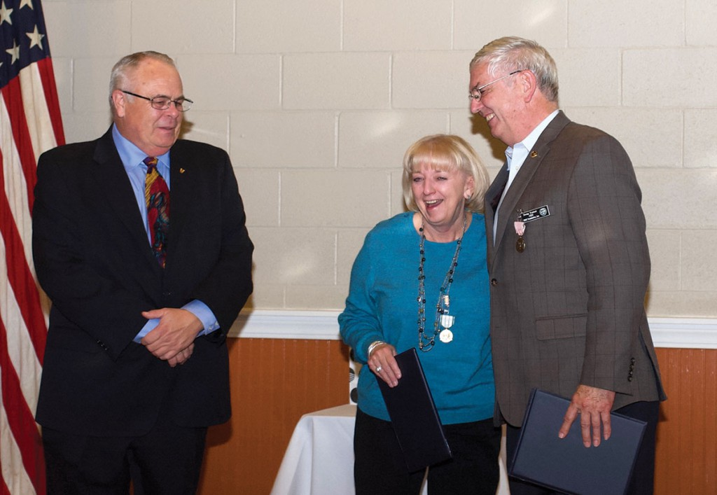 Doug and Ann share a light moment with Kirby Brown, left, the deputy to the commanding general of Fort Leavenworth, after receiving their retirement awards Nov. 16.