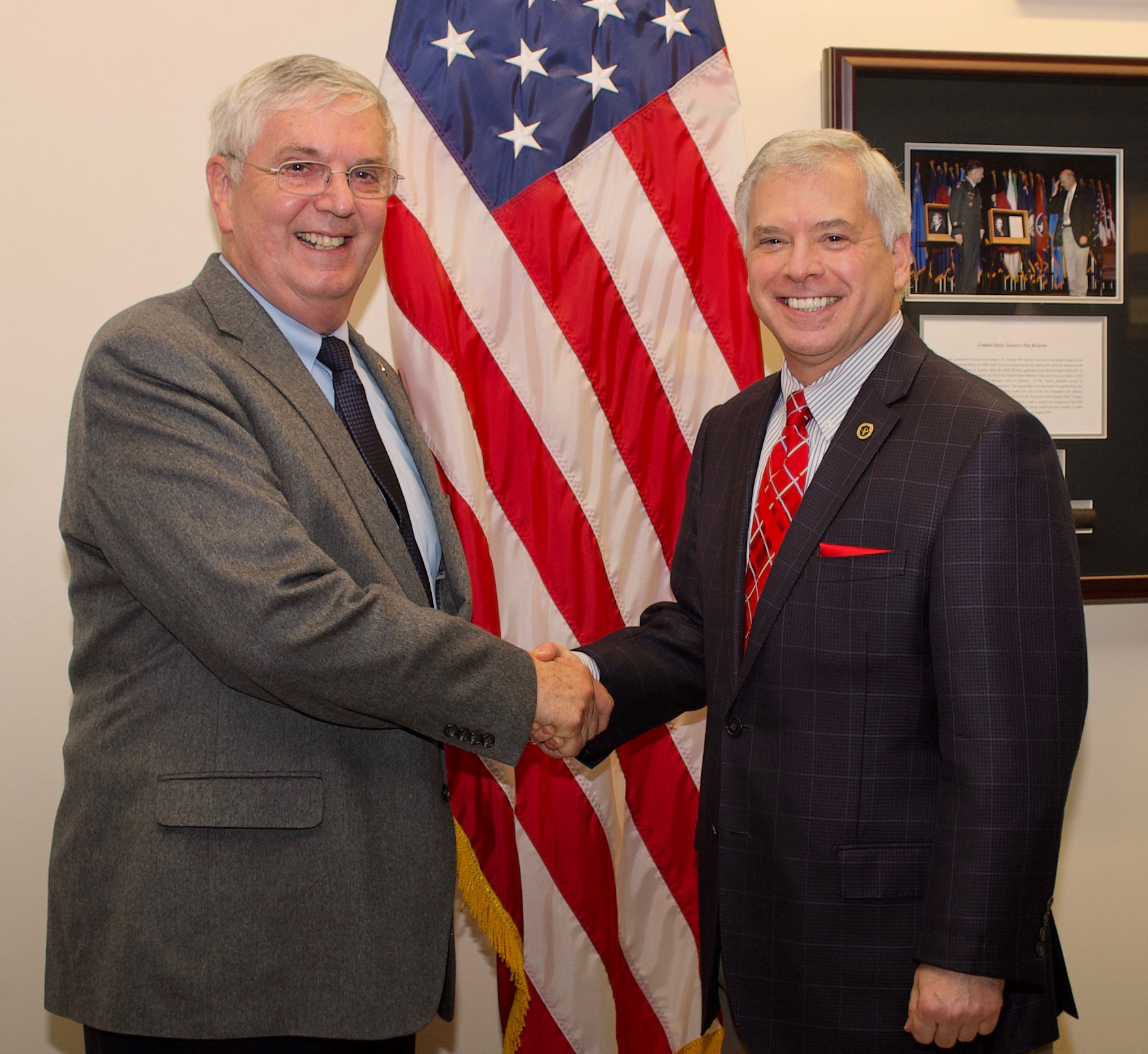 Colonel Roderick M. Cox. Cox, U.S. Army, retired (right) and then-outgoing CGSC Foundation CEO Colonel Doug Tystad, U.S. Army, retired (left) shake hands as Cox is prepares to take over as President and CEO of the CGSC Foundation in December 2018.
