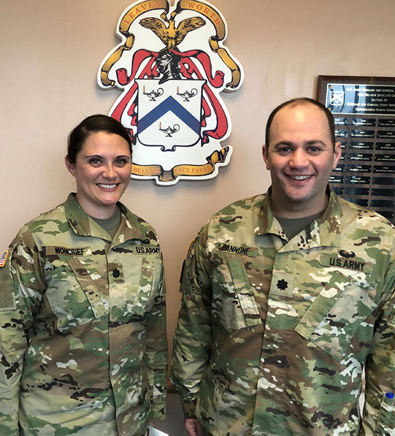 Lt. Col. Adam Pannone,  right, earned the TASS Military Instructor of the Year for 2018. Pannone is a CGSOC instructor at the Fort Belvoir CGSC satellite campus. With Pannone is Lt. Col. April Moncrief, the Virginia Coordinator for the 10-80th Officer Education System Battalion.