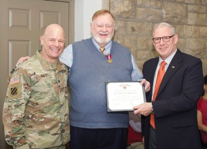 Col. Rob Ault, left, director of the Command and General Staff School, and Col. (Ret.) Dave Cotter, the director of the Military History Department, present Bud Meador with the Army Superior Civilian Service Award during Meador's retirement luncheon Jan 24 at the Frontier Conference Center on Fort Leavenworth.