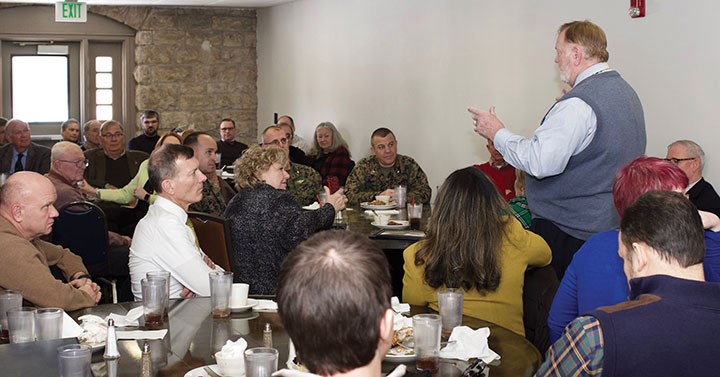 Bud Meador doing what he does best – holding court with an audience. Meador went around the room full of attendees thanking them by name during his retirement luncheon on Jan. 24.