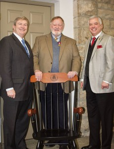 Foundation Chairman Mike Hockley, left, and Foundation President/CEO Rod Cox, right, presented Meador with a College chair for his service at the College and his role with the Foundation during Meador's retirement luncheon Jan. 24.