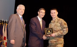 "photo- CGSC student Maj. Chase Spears receives his award for his paper ""Ethical Communication Approach for 21st Century Military Victory"" from Dr. Ted Thomas, director of CGSC's Department of Command and Leadership, and CGSC Foundation President/CEO Col. (Ret.) Roderick M. Cox."