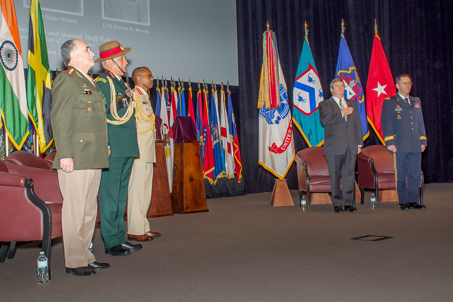 Command and General Staff College International Hall of Fame inductees, Gen. Bari del Valle Sosa, chief of the Joint Chiefs of Staff of the Armed Forces of Argentina, CGSC class of 1995; Gen. Bipin Rawat, chief of the Army Staff of the Indian Army, CGSC class of 1997; and Lt. Gen. Rocky Ricardo Meade, chief of Defence Staff, Jamaica Defence Force, CGSC class of 2003; Michael Hockley, CGSC Foundation chair and Civilian Aide to the Secretary of the Army for Eastern Kansas; and Army University Provost/CGSC Deputy Commandant Brig. Gen. Troy Galloway, stand at attention during the opening of the ceremony on April 4, 2019, at the Lewis and Clark Center.